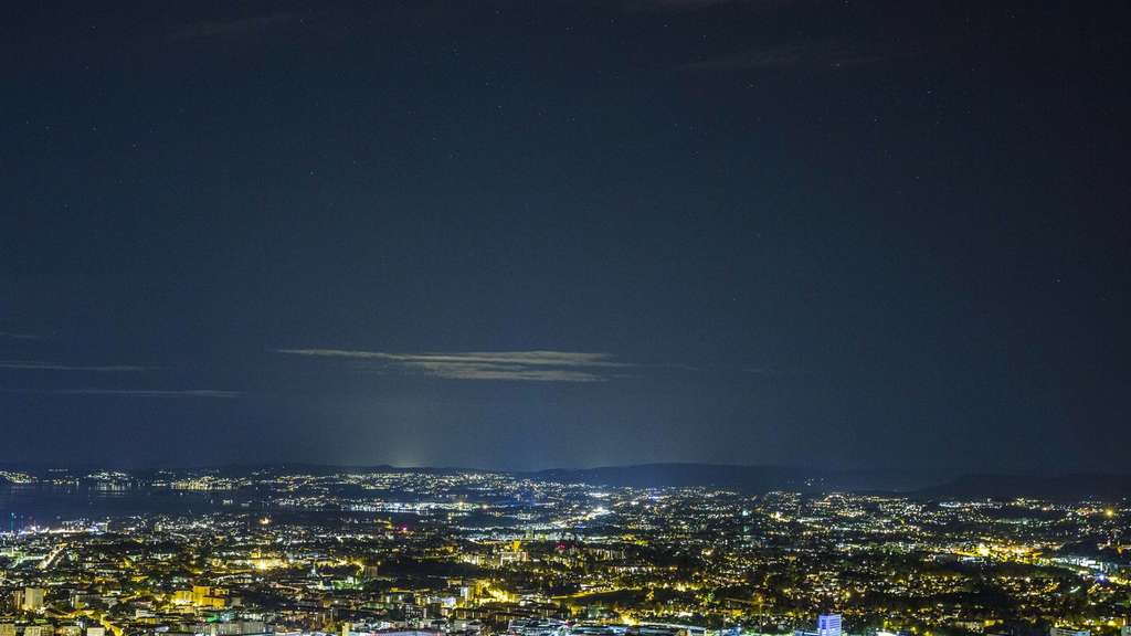 "A so-called ""super moon"" hangs in the sky over Oslo during a total lunar eclipse on September 28, 2015. Skygazers were treated to a rare astronomical event when a swollen ""supermoon"" and lunar eclipse combined for the first time in decades, showing Earth&#39s satellite bathed in blood-red light. AFP PHOTO / NTB SCANPIX / STIAN LYSBERG SOLUM +++ GERMANY OUT"